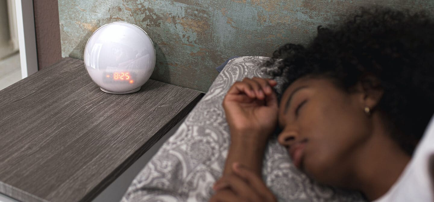 Woman sleeping early to boost her immune health