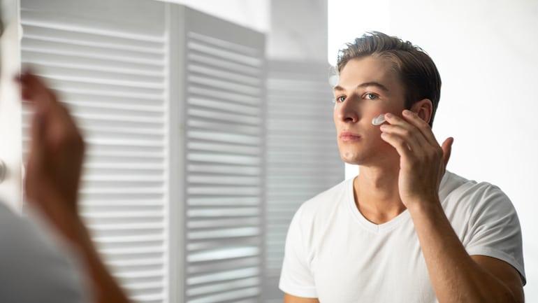 Man applying topical probiotic moisturizing cream
