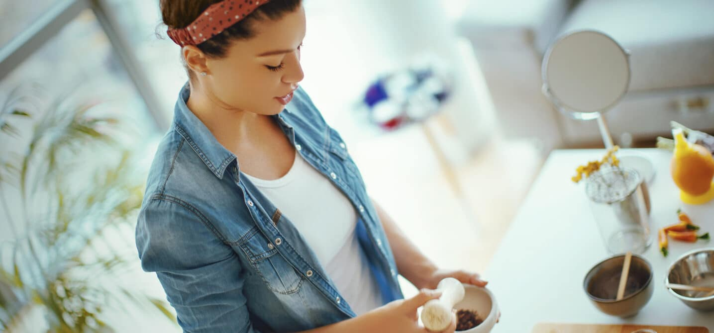 woman making herbal blend