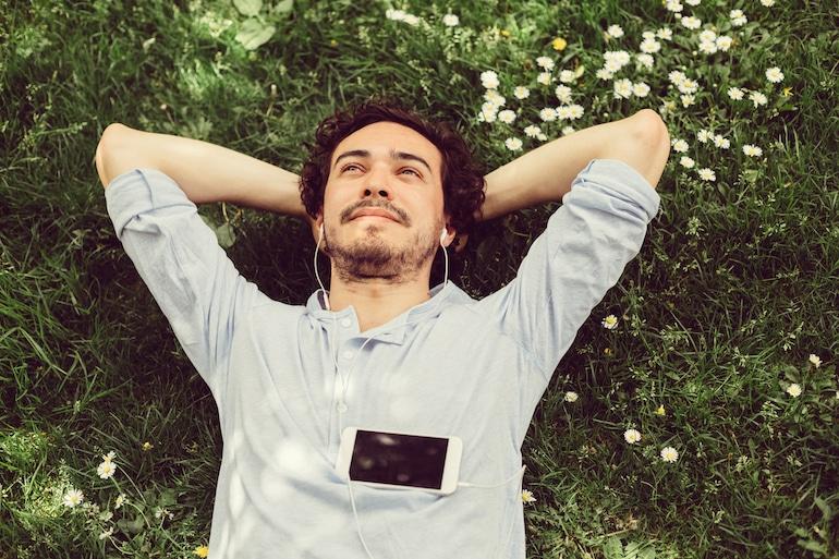man relaxing in grass