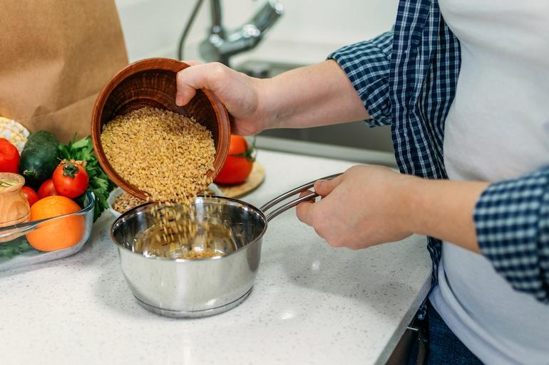 woman making ancient grains