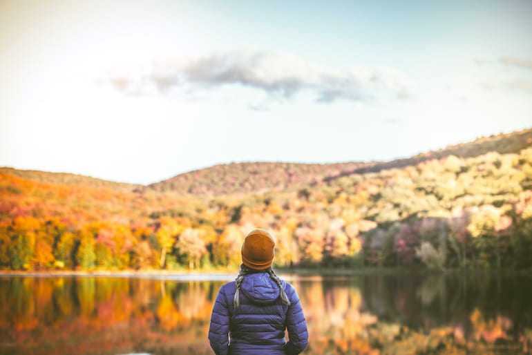 woman hiking in fall weather