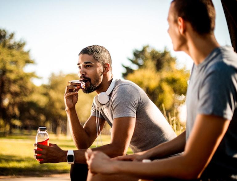 man eating protein bar