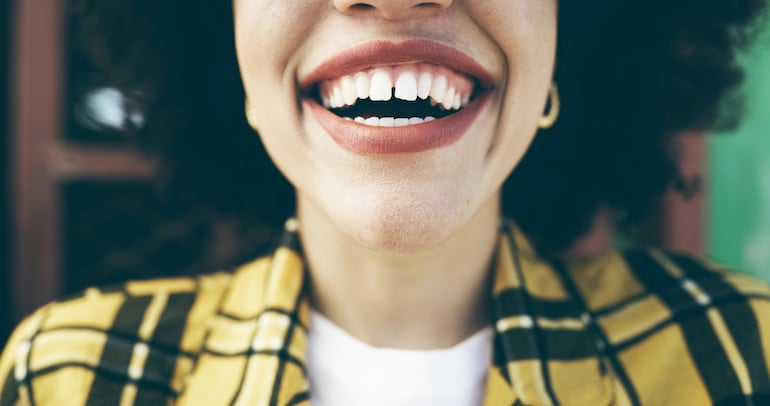 woman smiling with mouth open