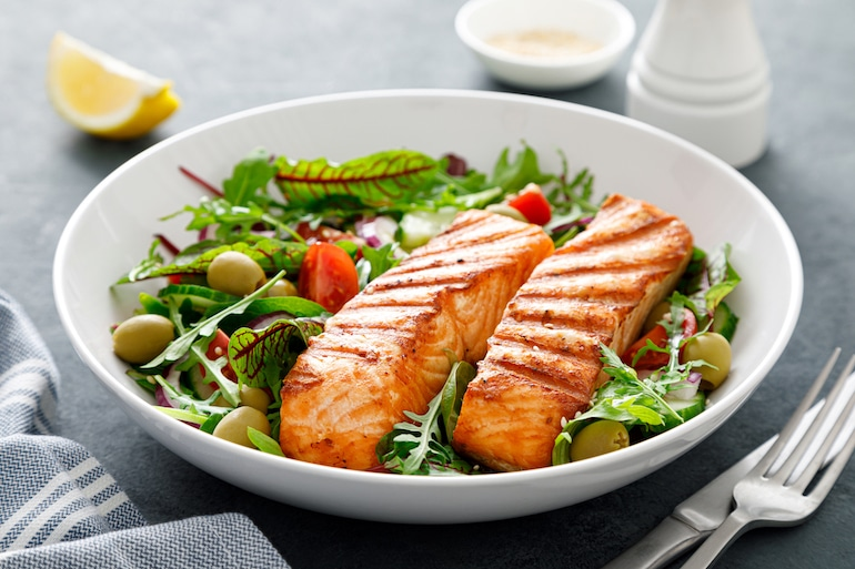 grilled salmon over greens