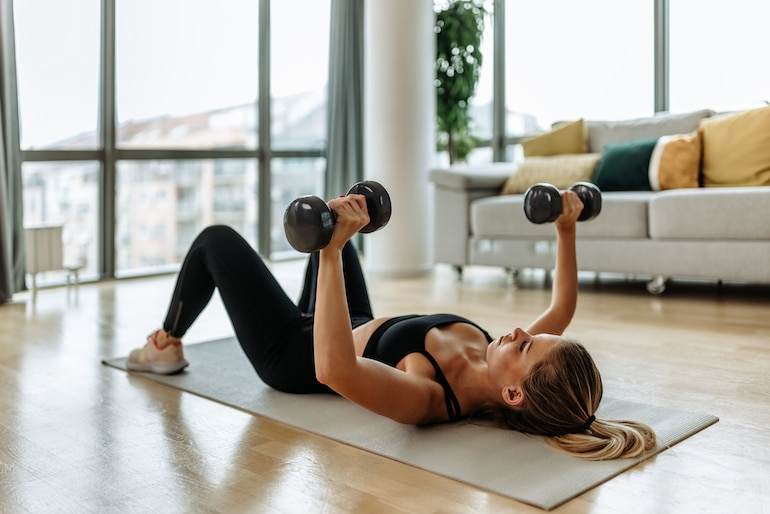 woman doing a chest press