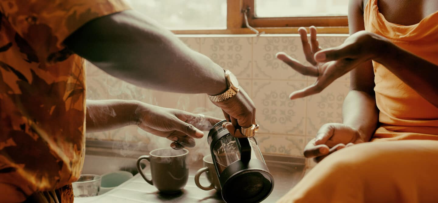 couple pouring coffee